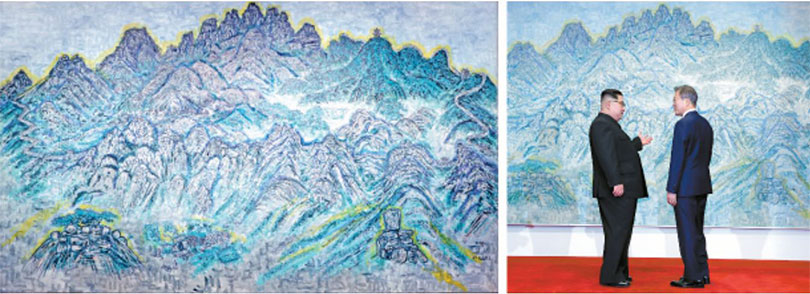Above, North Korean leader Kim Jong un asks South Korean President Moon Jae in about a painting hanging in Peace House in Panmunjom during the inter-Korean summit on Friday. The landscape painting 〈Mount Bukhan〉 left, was by South Korean artist Min Joung ki. photo by JOINT PRESS CORPS