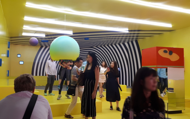 "At the lobby, the visitors experienced diverse contemporary artworks with various forms and methods, including ""Yourself Is sometimes a Place to Call Your Own"", a series of giant installations by Tobias Rehberger."
