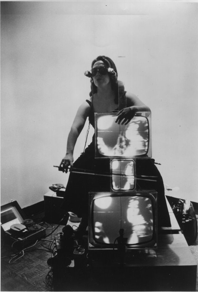 Charlotte Moorman with TV Cello and TV Eyeglasses 1971 Photograph, gelatin silver print Lent by the Peter Wenzel Collection, Germany. Image Provided by DongA.com